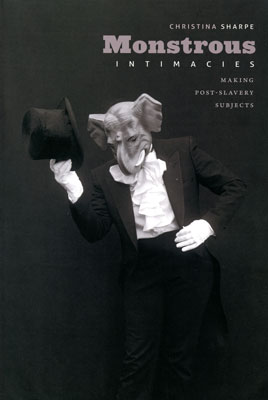 Cover of the book          Monstrous Intimacies with image of person in elephant mask and formal clothes from the Louisiana Project series by Carrie Mae Weems