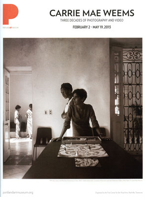 Page in Portland         Monthly Magazine with image of two women standing at the end of a table from the series Dreaming Cuba by Carrie Mae Weems