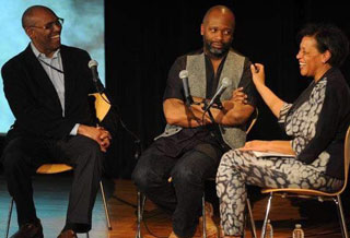 Photo of Carrie with Richard Powell and Theaster Gates in conversation at the Guggenheim Museum